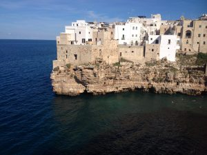 Site of an annual red bull cliff diving competition and the location that inspired the famed Italian classic song, Volare.