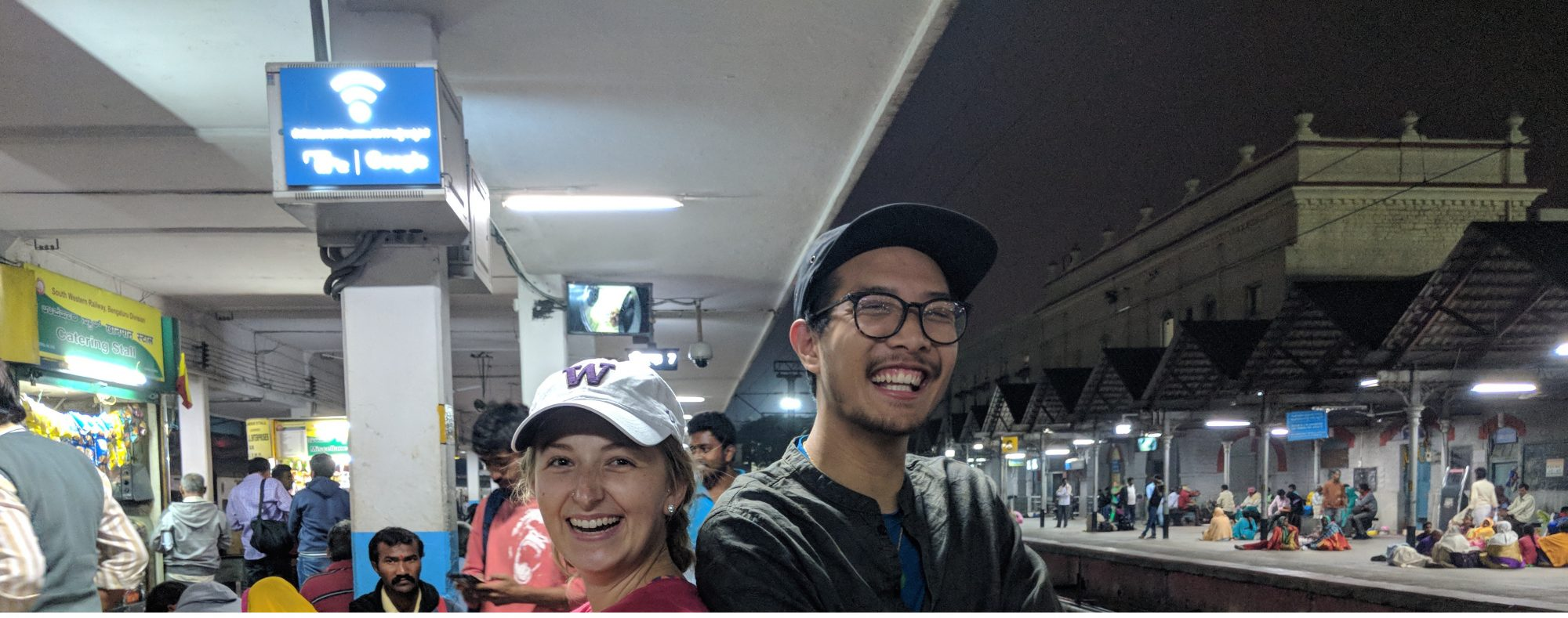 Olivia and Tyler at a train station in India.