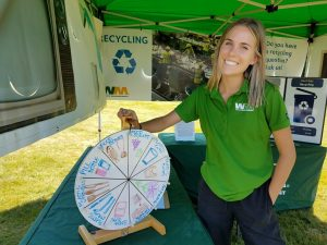 Brooke Stroosma fielding questions about recycling at a Waste Management info fair.