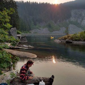 Rachel Fricke preparing zooplankton samples on the shores of Lake Kulla Kulla in Mt. Baker-Snoqualmie National Forest.