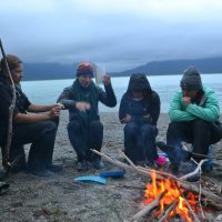 One of many deep conversations around a fire, here some 30 miles of paddling into the wilderness of Sit' Eeti Geeyi, the Huna Tlingit homeland in Glacier Bay National Park. During the course, each student took turns leading a discussion on a topic of their choosing, relating to course themes.